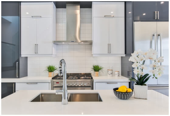 Fitted kitchen with multi function tap with hidden sink